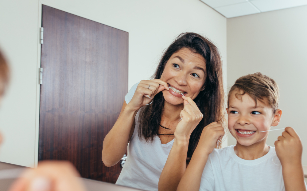 mother-and-child-flossing-together